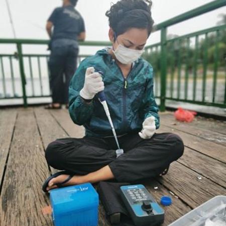 UCSC graduate student testing water samples.