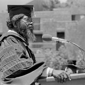 Prof. J. Herman Blake speaking at a graduation ceremony at Oakes College.